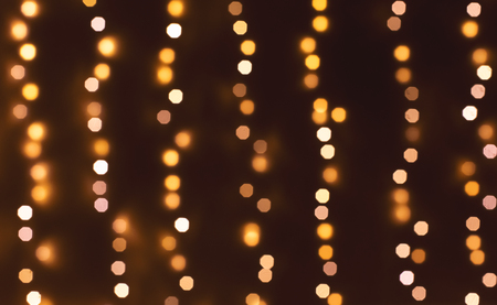 Bokeh abstract blurred lights vertical strings background