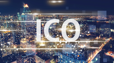 ICO with the New York City skyline at night