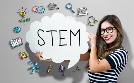 STEM text with young woman holding a speech bubble Stock Photo