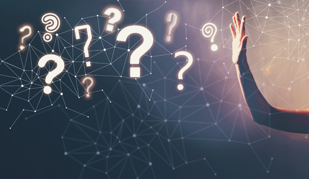 Question Marks with a hand in a dark light background Stock Photo - 101736573