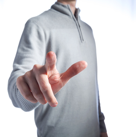 Man in pointing or pressing something on a white background