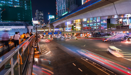 TOKYO, JAPAN - SEPTEMBER 25, 2017: People and traffic cross a busy intersection in Shibuya, Tokyo Japan at night. Editorial