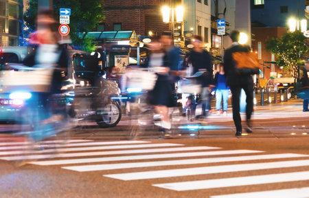 MATSUYAMA, JAPAN - OCT, 24 2017: People cross an intersection in Matsuyama, Japan Editorial
