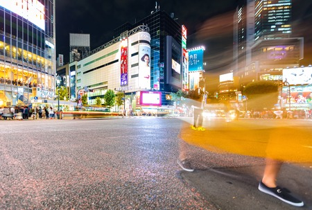 TOKYO, JAPAN - SEPTEMBER 25, 2017: People cross the Shibuya Scramble crosswalk, one of the busiest intersections in the world. Stock Photo - 118177810