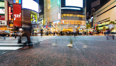 TOKYO, JAPAN - SEPTEMBER 25, 2017: People cross the Shibuya Scramble crosswalk, one of the busiest intersections in the world. Stock Photo - 118177813
