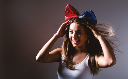 Happy Young woman with red and blue ribbon
