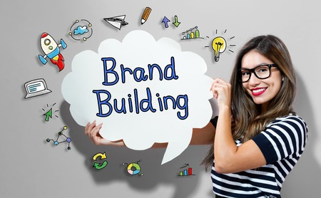 Brand Building text with young woman holding a speech bubble