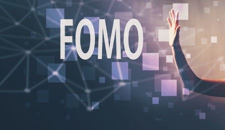 FOMO with a hand in a dark light background Stok Fotoğraf