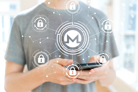 Monero cryptocurrency security theme with young man using a smartphone