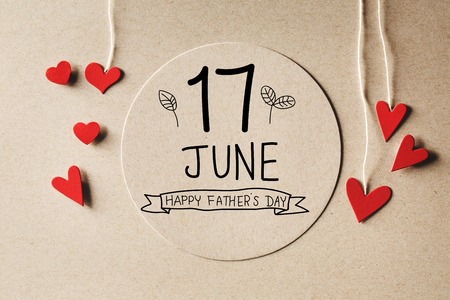 17 June Happy Fathers Day message with handmade small paper hearts Stock Photo