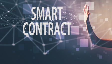 Smart Contract with a hand in a dark light background Фото со стока
