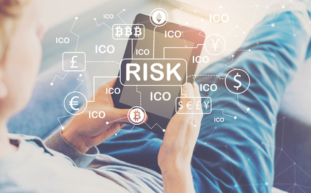 Cryptocurrency ICO Risk Theme with man using a tablet in a chair Zdjęcie Seryjne