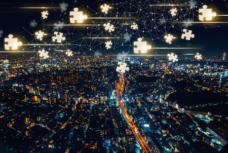 Puzzle Pieces with aerial view of Tokyo, Japan at night