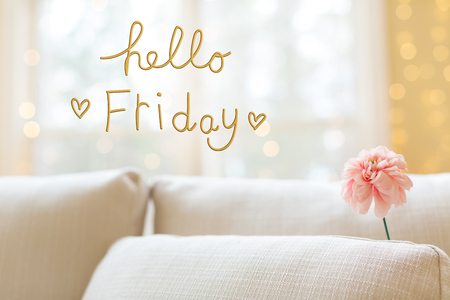 Hello Friday message with a flower in a bright interior room sofa Reklamní fotografie