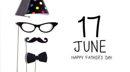 Fathers day message with glasses and moustache party sticks Stock Photo