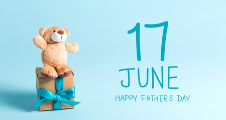 Fathers day message with teddy bear and gift box Stock Photo