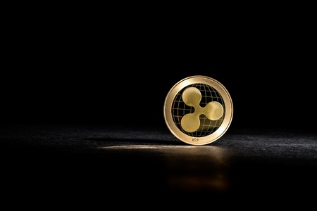 Ripple cryptocurrency coin on a dark background Zdjęcie Seryjne