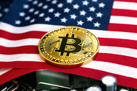 Bitcoin cryptocurrency coin with the national flag of the United States
