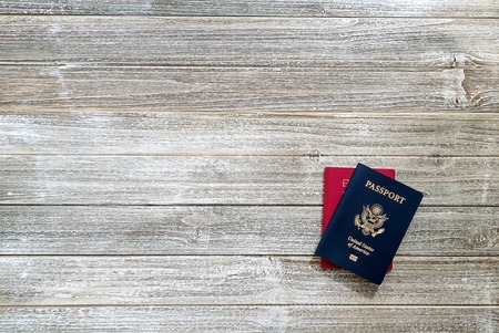 US and Japanese passport on a wooden desk from above