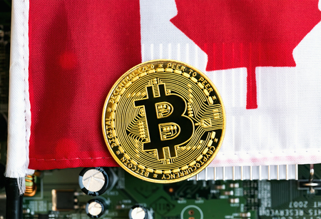 Bitcoin cryptocurrency coin with the national flag of Canada Stock Photo
