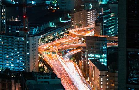 Aerial view of a highway interesection in Minato, Tokyo, Japan at night
