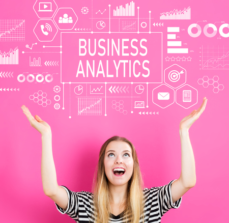Business Analytics with young woman reaching and looking upwards Stock Photo
