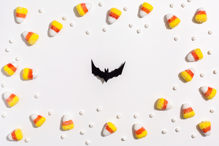 Halloween paper bat overhead view on a solid color Stockfoto