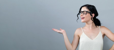 Young woman with a displaying hand gesture Stock Photo