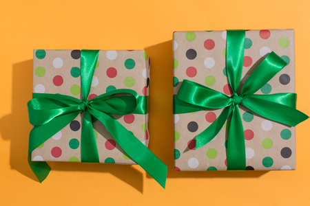 Two gift boxes on a orange background