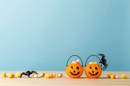 Halloween pumpkins with spider on a blue background