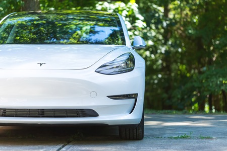 RALEIGH, NC - JULY 08, 2018: An all electric Tesla Model 3 in Raleigh, NC. The Model 3 is set to be the Tesla's first mass market electric vehicle.