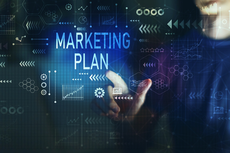 Marketing plan with young man touching screen at night Imagens