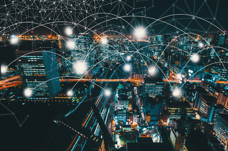 Network and connection technology concept with aerial view of Tokyo, Japan at night Фото со стока