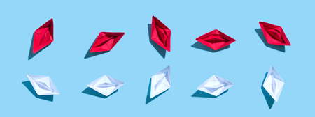 Collection of paper boats on a blue background