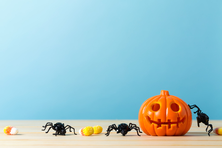 Halloween pumpkin with spider on a blue background