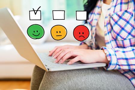 Survey with young woman using a laptop computer Фото со стока