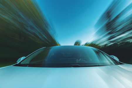 Luxury vehicle driving down the road with motion blur Stock Photo - 108292693