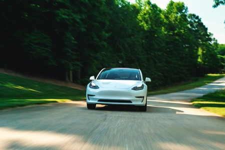 RALEIGH, NC - JUNE 10, 2018: An all electric Tesla Model 3 in Raleigh, NC. The Model 3 is set to be the Teslas first mass market electric vehicle.