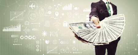 Travel theme with business man displaying a spread of cash Stock Photo