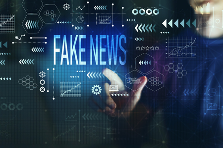 Fake news with young man on a dark background