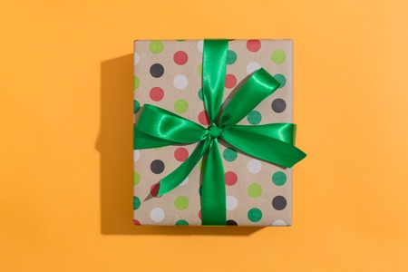 A gift box on a orange background