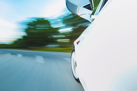 Luxury vehicle driving down the road with motion blur Stock Photo - 108424472