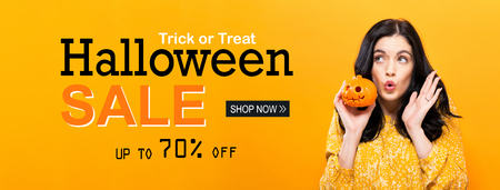 Halloween sale with young woman holding a pumpkin