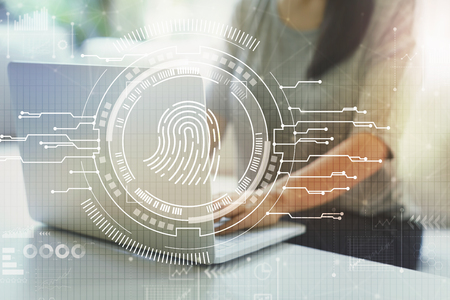 Fingerprint scanning theme  with woman using her laptop in a living room