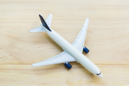 A toy airplane on wooden table - overhead view 版權商用圖片