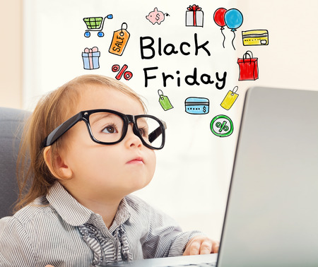 Black Friday text with toddler girl using her laptop