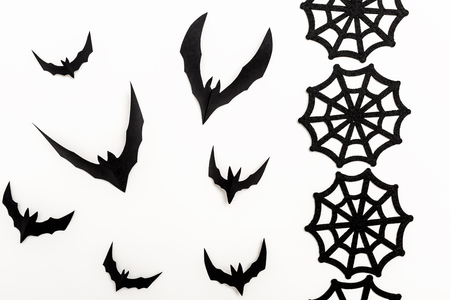 Halloween bats and spider webs on a white background