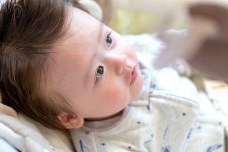 Newborn baby boy sitting in his rocking swing Standard-Bild - 109268962
