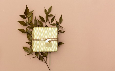 Autumn themed present box on a light brown paper background