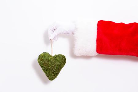 Santa claus holding a herat ornament on a white background Banco de Imagens